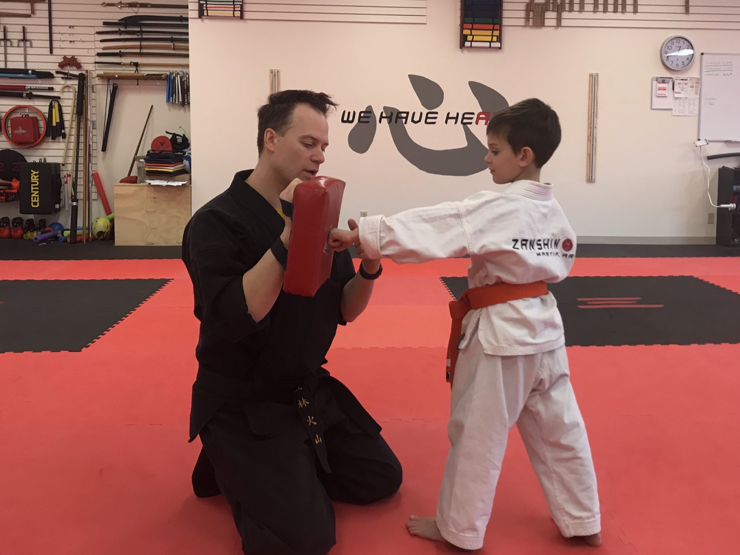 instructor-coaches-kid
