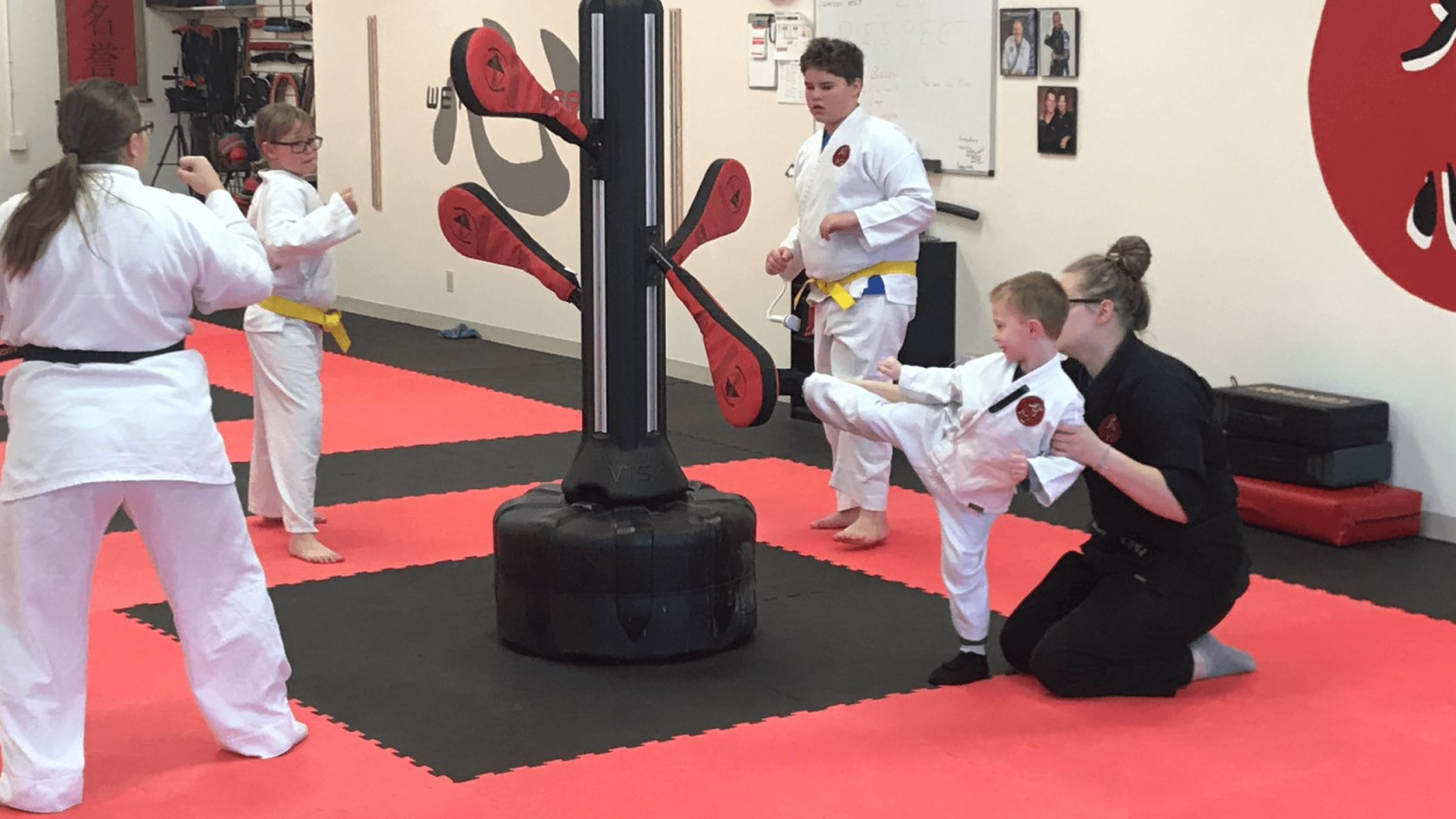 kid-and-instructor-round-kick