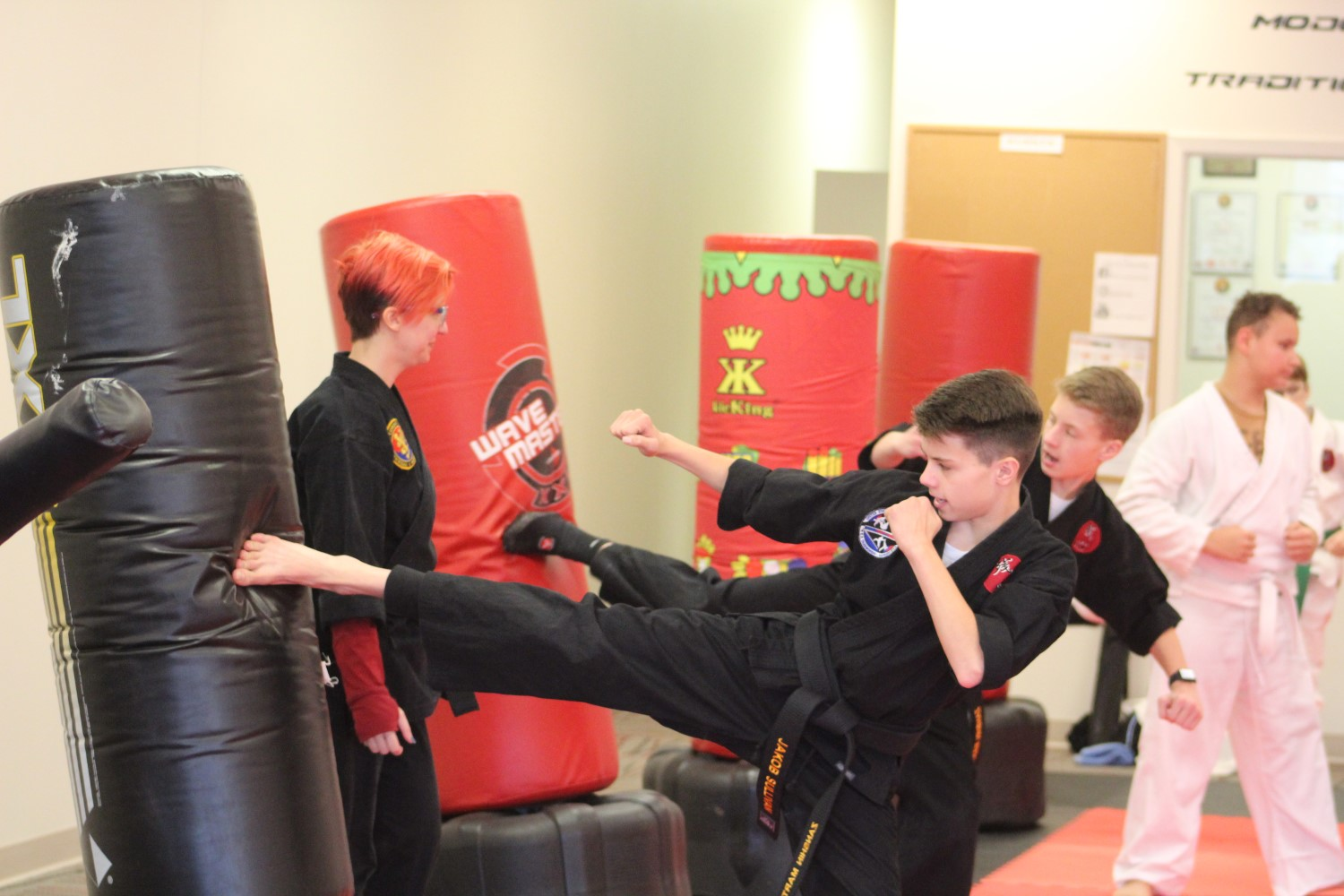 black-belts-kicking